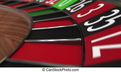 Casino roulette wheel ball hits 21 twenty-one red