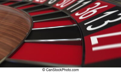 Casino roulette wheel hits 24 twenty-four black, close-up shot