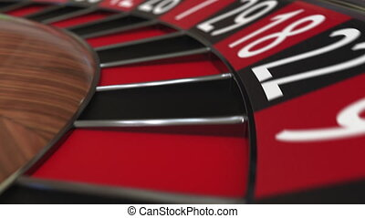 Casino roulette wheel ball hits 26 black