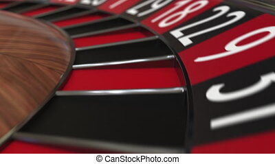 Casino roulette wheel ball hits 3 three red