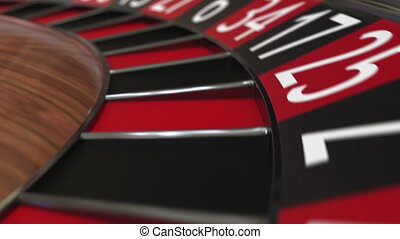 Casino roulette wheel ball hits 30 thirty red, close-up shot