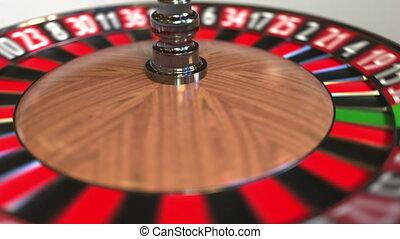 Casino roulette wheel ball hits 33 thirty-three black. 3D...