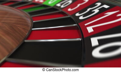 Casino roulette wheel ball hits 4 four black, close-up shot