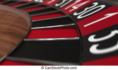 Casino roulette wheel ball hits 7 seven red