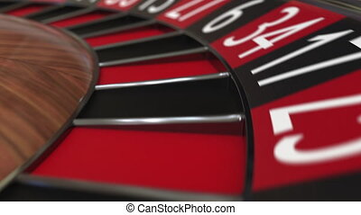 Casino roulette wheel hits 8 eight black, close-up shot