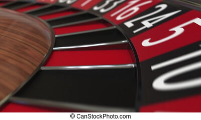 Casino roulette wheel ball hits 9 nine red