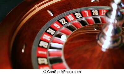 casino roulette wheel in motion. numbers on the roulette ...
