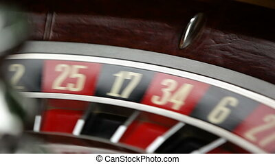 casino roulette wheel in motion. numbers on the roulette wheel close-up