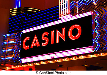 casino sign in lights - a casino sign in bright red lights
