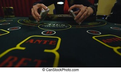 Casino stickman takes the cards from card holder at the game...
