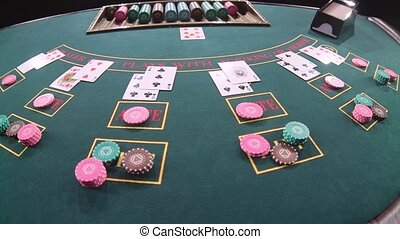 Casino table poker game. Slow motion. Close up