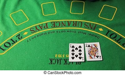 Casino table with poker player hands and playing card