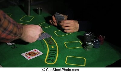Casino table with poker player hands and playing card. Woman have a winning combination