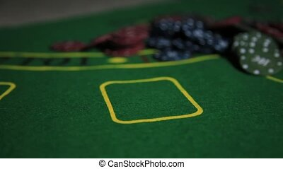 Casino table with poker player hands and playing card.