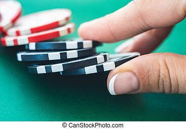 Casino tokens on poker table