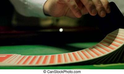 casinos, the dealer shuffles the cards