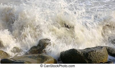 sea waves breaking on coastal stones, Caspian Sea, Iran