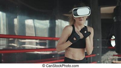 casque à écouteurs, formation, femme, boxe, réalité virtuelle, donner coup pied, vr, séduisant, 360