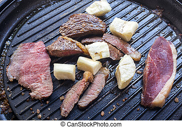 Cassava steak with roast on the plate