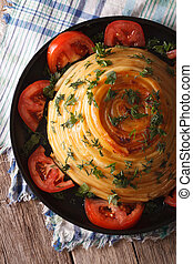 Casserole pasta with cheese close-up on a plate. vertical top view