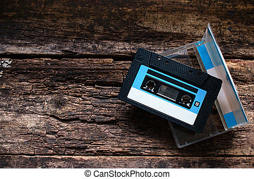Cassette in an open box on a wooden table