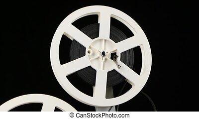Cassette projector rotate film in frame. Studio - Cassette...