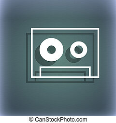 cassette sign icon. Audiocassette symbol. On the blue-green abstract background with shadow and space for your text.