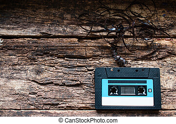 Cassette tape on a wooden background