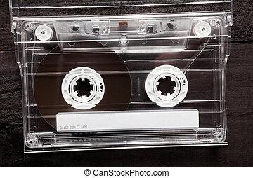 Cassette tape - Vintage Compact Cassette on black wooden ...