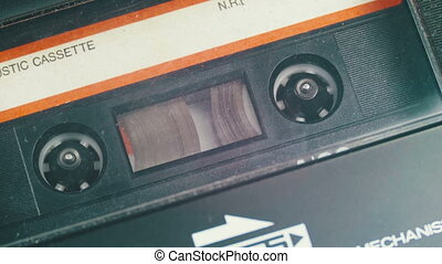 Cassette Tape with a White Blank Label.