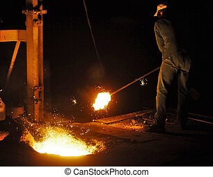 Cast iron factory - A man working in a cast iron factory...