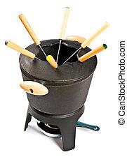 cast iron fondue set isolated on white