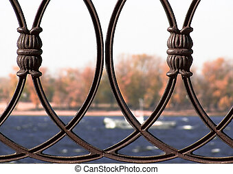 cast iron grill fence. against the backdrop of the fall of ...