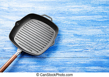 cast iron grill pan - New cast-iron grill pan on a wooden ...