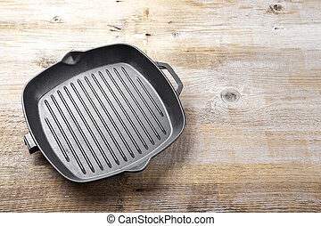 cast iron grill pan - New empty cast-iron grill pan with two...
