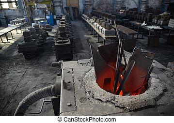 cast iron in progress - scrap steel melts down in an...