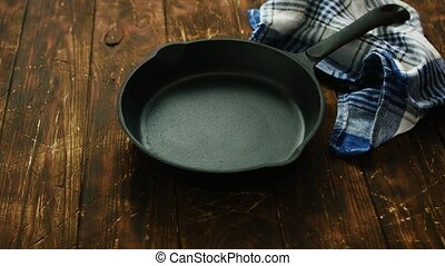 Cast iron pan on table - Simple black colored cast iron pan...