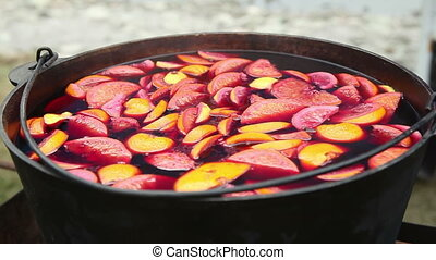 Cast iron pot with mulled wine. Russian holiday Maslenitsa
