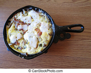 Cast Iron Skillet Omelet - An omelet served in a small cast ...