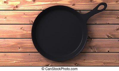 Cast iron skillet on wood background. 3DCG render animation....