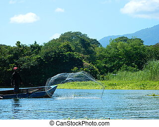 Cast the Net - This is a photo of a man fishing with a cast...