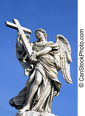 Statue of angel holding cross outside Castel'Angelo in Rome, Italy.