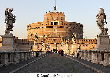 Castel Sant'Angelo at sunset with tourists - no face can be identified