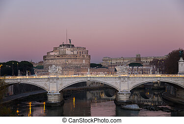 Castel Sant'Angelo in Rome with bridge at sunset.