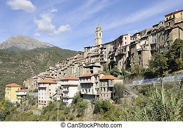 view of medieval mediterranean village in hilly inland landscape
