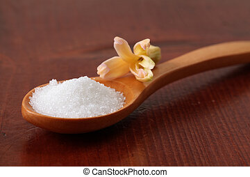 Caster sugar in a wooden spoon