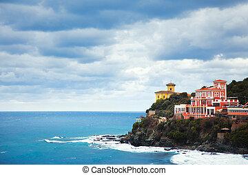 Castiglioncello landmark on cliff rock and sea. Tuscany, Italy.