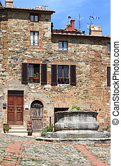 Castiglione d' Orcia in Tuscany - Medieval square with water...