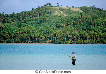 Casting for bonefish in Aitutaki Lagoon Cook Islands
