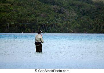 Casting for bonefish in Aitutaki Lagoon Cook Islands -...